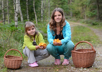 Portrait of girls picking mushrooms