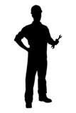 A silhouette of a confident and smiling handyman holding a wrenc