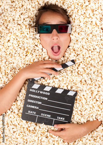 young girl buried in popcorn