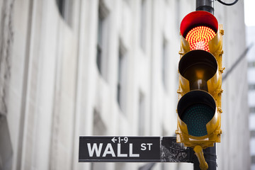 Wall street and red traffic  light