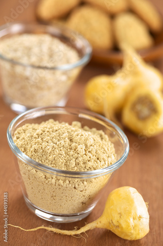 canvas print picture Maca powder (flour) with maca roots / Peruvian ginseng