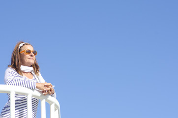 Happy Mature woman cruise sky background