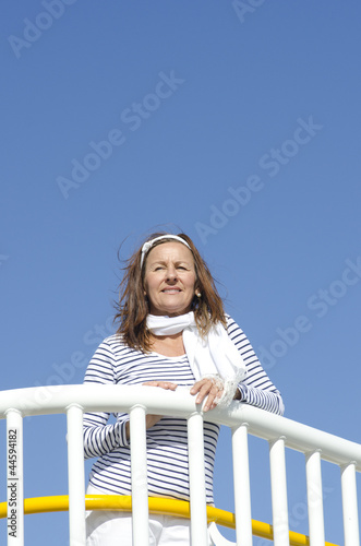 Active mature woman sky background
