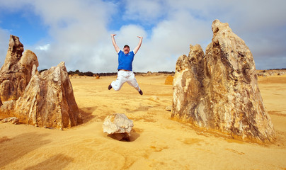 Jump in Pinnacles Desert, Australia