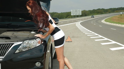 Attractive Woman with her Broken Car