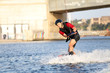 Wakeboarder surfing across a river - 44598996