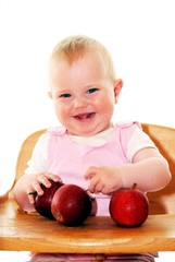 happy little girl with apples
