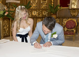 Groom and Bride signing the register in church