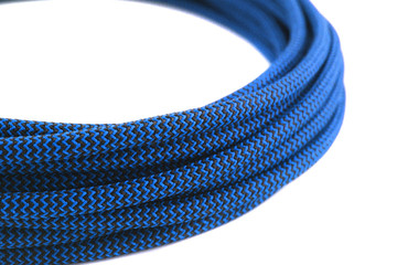 Closeup of blue rope on white background
