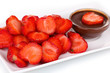 Fresh strawberries on plate with chocolate close-up
