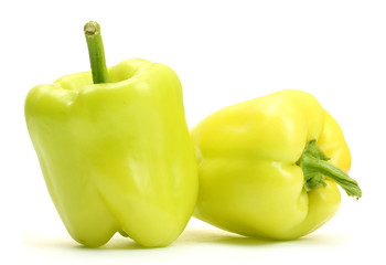 fresh green bell peppers isolated on white