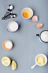 Baking ingredients flour butter eggs with measuring spoons