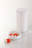 Dispenser for tablets with bottle with pills isolated on white