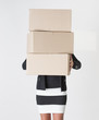 Woman carrying carboard boxes