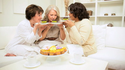 Older Ladies Tempted Coffee Muffins Home Couch