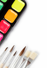 Brushes and paints isolated on a white background.