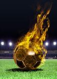 Fototapety fiery soccer ball on field