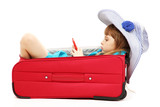 Portrait of little girl in travel case with hat isolated