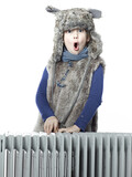 Cute girl with pelt cap leaning over a radiator and shouting poster