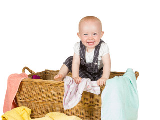 Joyful toddler in wicker basket