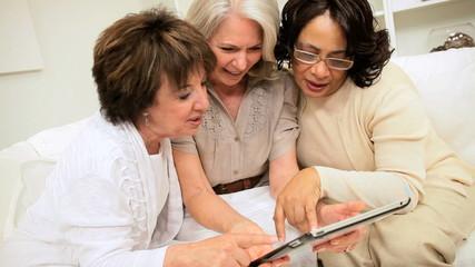 Senior Female Friends Home Wireless Tablet Networking