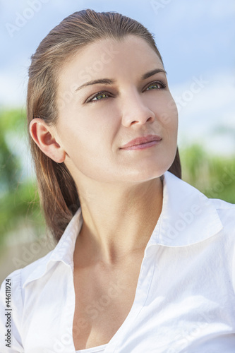 Outdoor Portrait of Beautiful Woman With Green Eyes