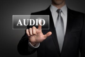 businessman pressing virtual button - audio