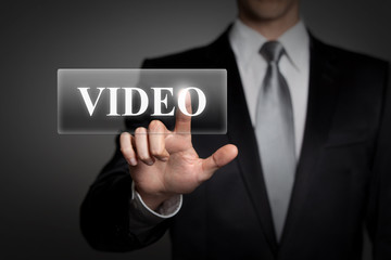 businessman pressing virtual button - video