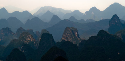 Mountain range image of Guilin at sunset. Yangshuo, China, Asia