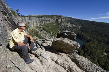 Senior man sitting and looking at view