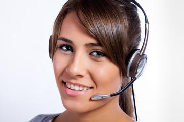 Operadora de centro de llamadas con auriculares