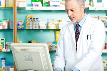 Pharmacist in his store