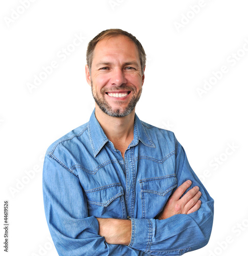 Smiling man in denim shirt isolated on the white background