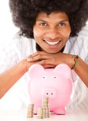 Black man with a piggybank