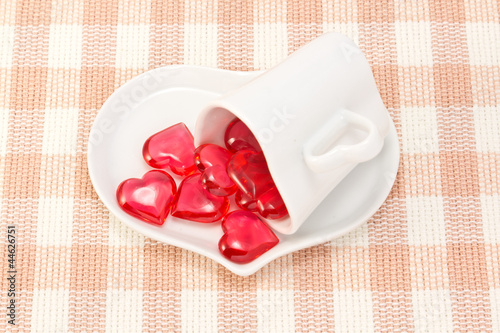 Red heart and heart shaped coffee cup