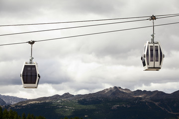 Two cable cars in the mountains