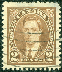 stamp printed in Canada showing king George VI
