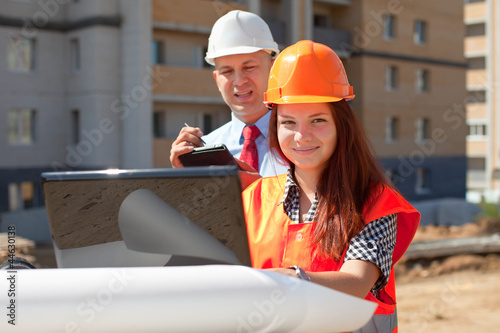 two builders works on the building site