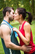 Young sport kissing couple