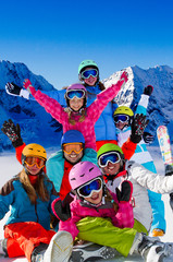 Skiing, winter fun - happy skiers, family ski team