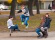 Teenage boys and girls having fun in the park
