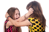 Two teenage girls pulling each others hair
