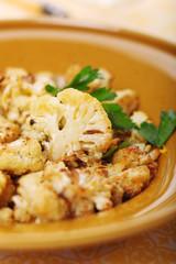 Roasted cauliflower with lemon peel and garlic.