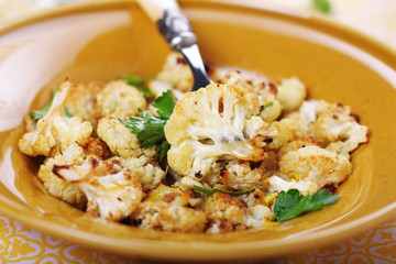 Roasted cauliflower with lemon peel and garlic.