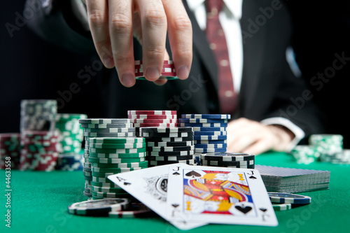 canvas print picture blackjack in a casino, a man makes a bet, and puts a chip
