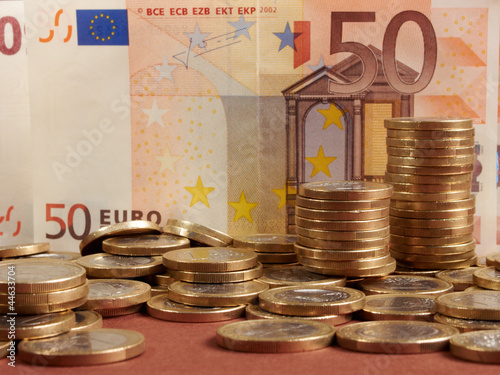 Euro coins on banknote money background