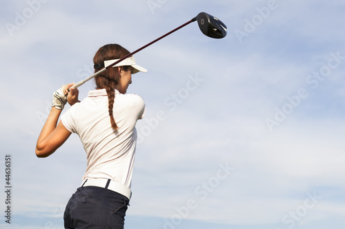 Golf player teeing off