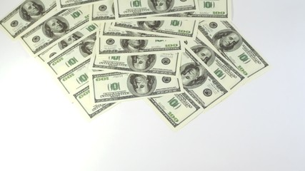 Hundred dollar banknotes appear and disappear from screen