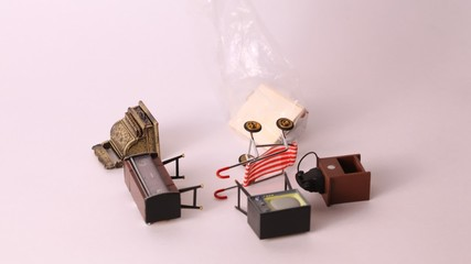 Furniture for dolls: TV, phone, carriage school board appears