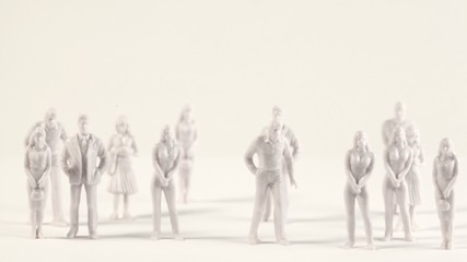 White miniatures of men and women appear on screen